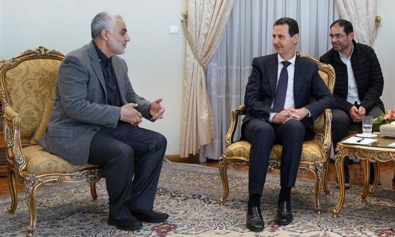 رئيس النظام السوري بشار الأسد وقائد فيلق القدس الإيراني قاسم سليماني (وكالة تسنيم الإيرانية)