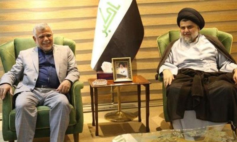 مقتدى الصدر وهادي العامري خلال اجتماق سابق (قناة العالم الإيرانية)