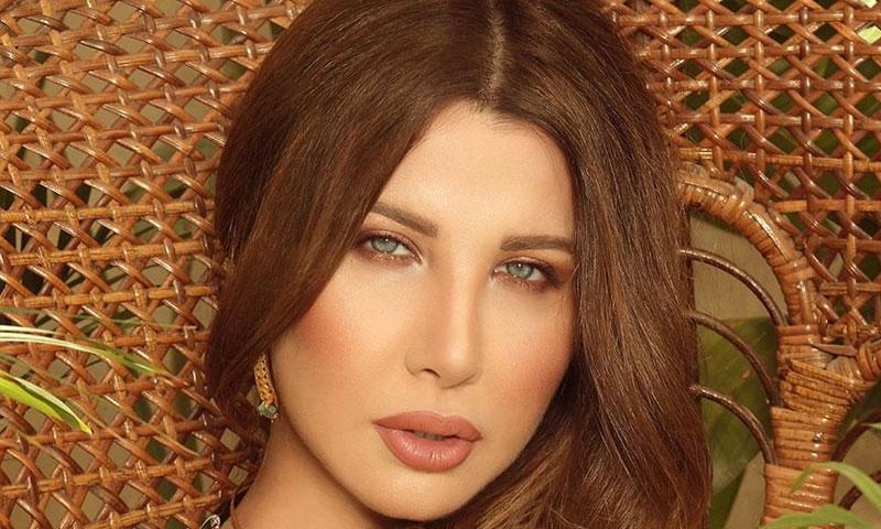 """المغنية نانسي عجرم (الصفحة الرسمية في """"فيس بوك)"""