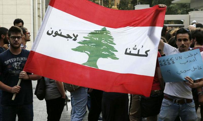 مظاهرة سابقة للتضامن مع اللاجئين السوريين في لبنان (العربي الجديد)