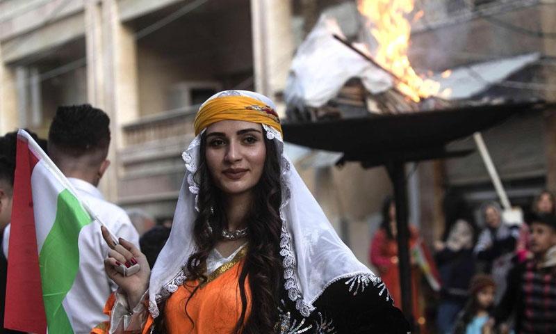 """احتفالات عيد """"النوروز"""" في شمال شرقي سوريا- 21 من آذار (AFP)"""
