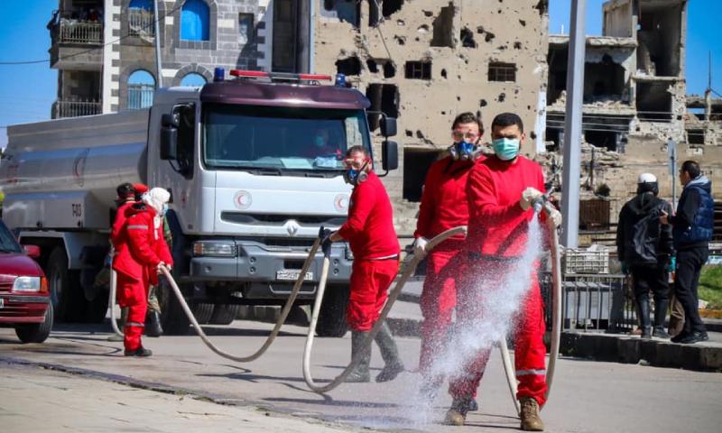 حملة لتعقيم الأحياء ومراكز الإيواء بمدينة حمص من قبل منظمة الهلال الأحمر (الهلال الأحمر السوري)