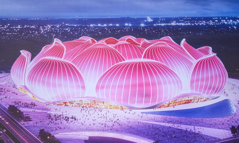 """صورة تصميمية مصورة على لوحة خلال حفل وضع حجر الأساس لملعب """"زهرة اللوتس"""" في مدينة جوانزو جنوبي الصين- 16 من نيسان (AFP via Getty Images)"""
