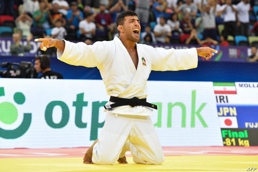 فرح الإيراني سعيد مولاي بعد فوزه في وزن أقل من 81 كجم رجال في بطولة العالم للجودو في باكو- 23 من كانون الأول 2018(فرانس برس)