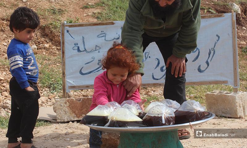 والدها أحمد المحمد، نجا بنفسه وبعائلته بنزوحه من بلدة كنصفرة جنوبي إدلب