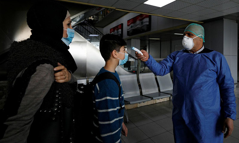 فحص القادمين عبر مطار دمشق الدولي