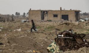 """بلدة الباغوز بعد عام من خروج تنظيم """"الدولة الإسلامية"""" – 21 من آذار 2020 (AFP)"""