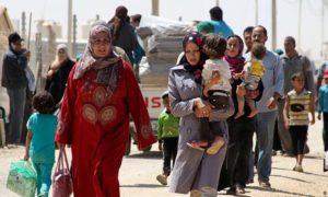 لاجئون سوريون في الأردن (رويترز)