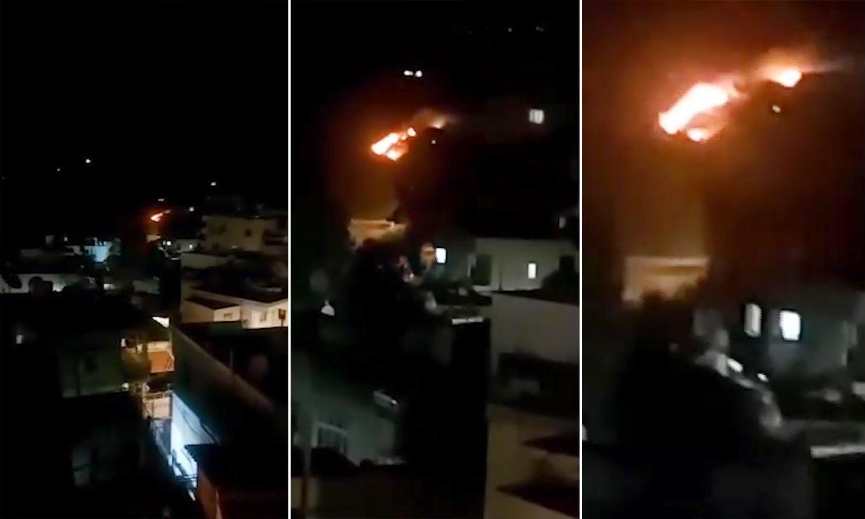 صورة تظهر الحرائق في بلدة عين التينة بعد القصف الاسرائيلي (الإخبارية السورية/ تعديل عنب بلدي)