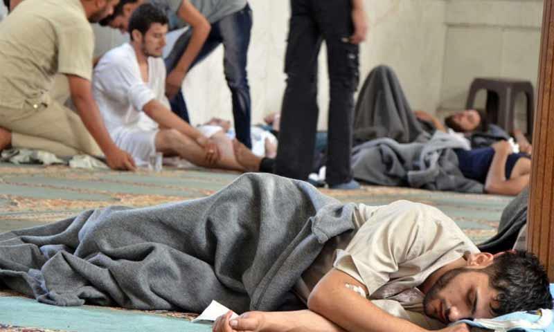 ناج من الهجوم الكيماوي في دوما – آب 2013 (رويترز)