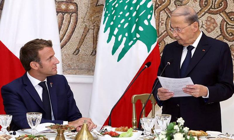 الرئيس الفرنسي إيمانويل ماكرون واللبناني ميشيل عون 1 من أيلول 2020 (الأناضول)