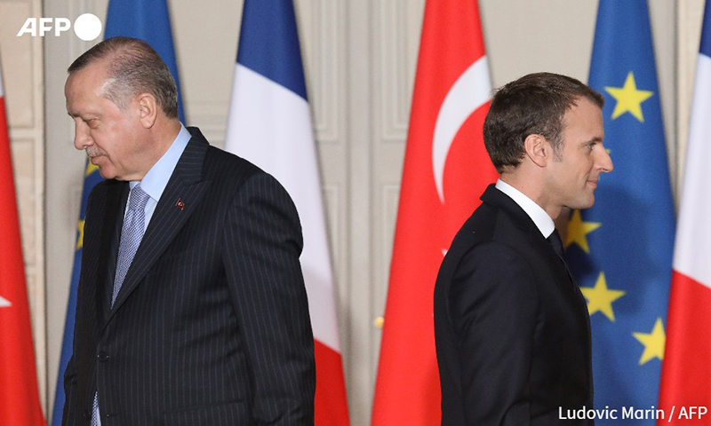 الرئيس التركي رجب طيب أردوغان والرئيس الفرنسي إيمانويل ماكرون- 4 من كانون الأول (فرانس برس)