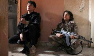 مقاتلين أطفال ضمن الوحدات الكردية في سوريا ( المصدر_ موقع جيتي)