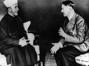 أدولف هتلر يتحدث إلى المفتي العام الحاج محمد أمين الحسيني تصوير كيستون