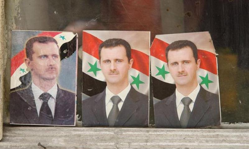 ملصقات دعائية لرئيس النظام السوري بشار الأسد (James Gordon/Flickr)