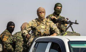 """عناصر من """"قوات سوريا الديمقراطية"""" (AFP)"""