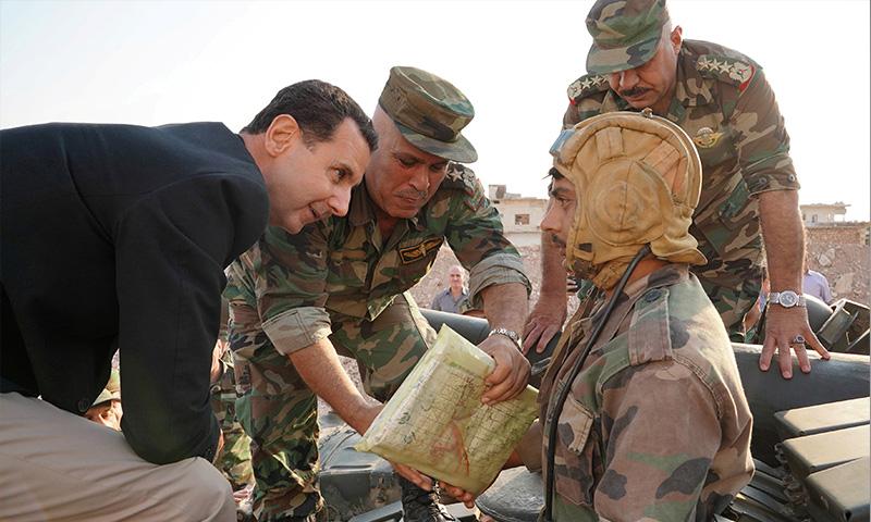 عناصر من قوات النظام السوري خلال الحملة العسكرية في القنيطرة - تموز 2018 (رويترز)
