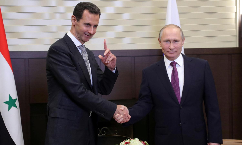الرئيس الروسي، فلاديمير بوتين، ورئيس النظام السوري، بشار الأسد، في موسكو في 2017 (الغارديان)
