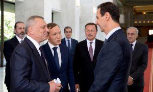 نائب رئيس الوزراء الروسي، يوري بوريسوف، مع رئيس النظام السوري، بشار الأسد، بدمشق - 22 من حزيران 2021 (رئاسة الجمهورية العربية السورية)