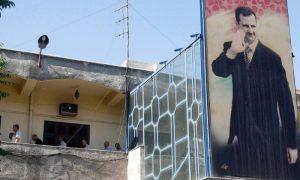 معتقلون سياسيون احتجزوا داخل مركز شرطة تابع للنظام السوري بدمشق- 11 من تموز 2012 (رويترز/ خالد الحريري)