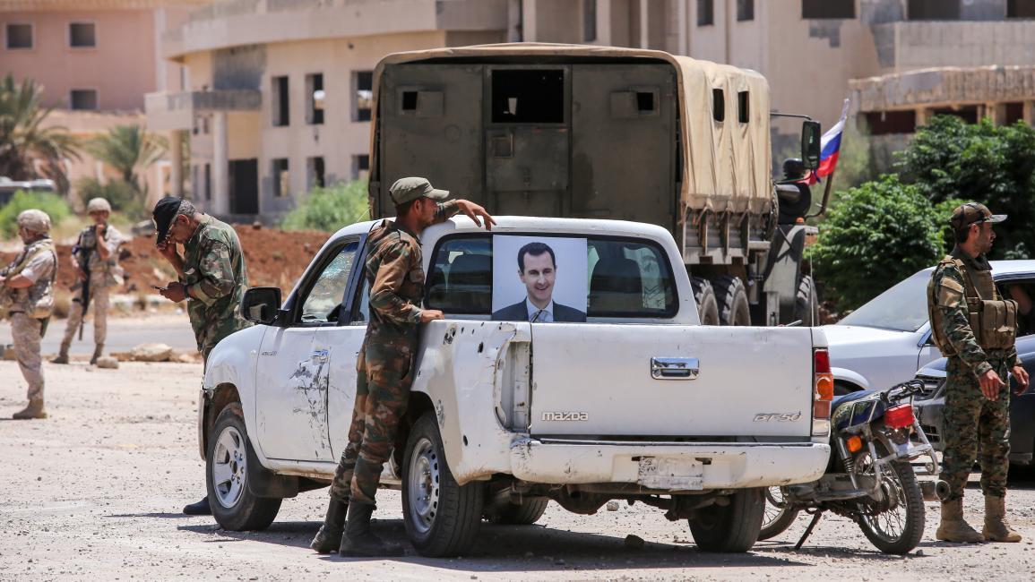 تجمع لعناصر من قوات النظام السوري في درعا (AFP)