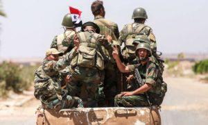 عساكر تابعين لقوات النظام السوري (Getty Images)