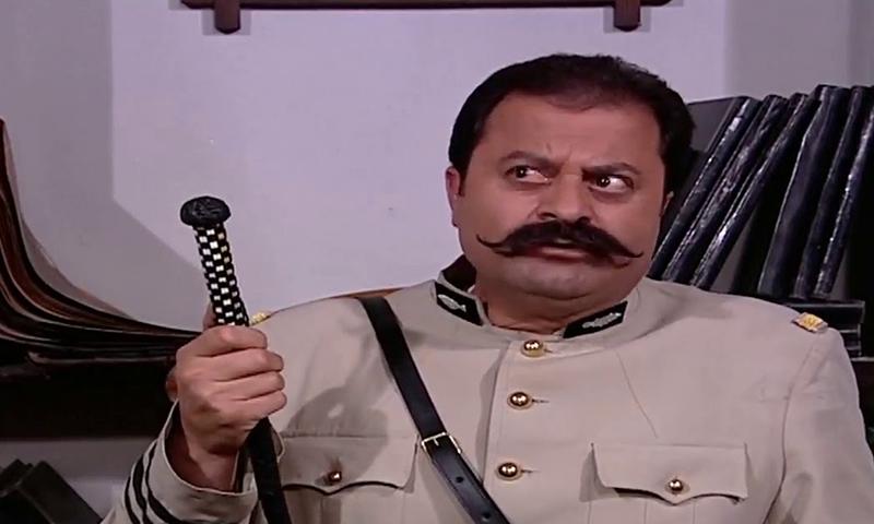 زهير رمضان بدور أبو جودت خلال أحد مشاهد مسلسل باب الحارة