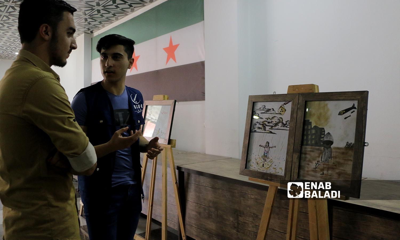 معرض فني إحياءً لذكرى مجزرة كيماوي الغوطة الشرقية في مدينة إعزاز - 21 آب 2021 (عنب بلدي - وليد عثمان)