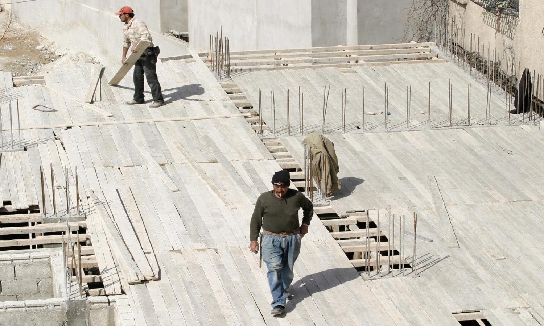 عمليات البناء في سوريا (AFP)