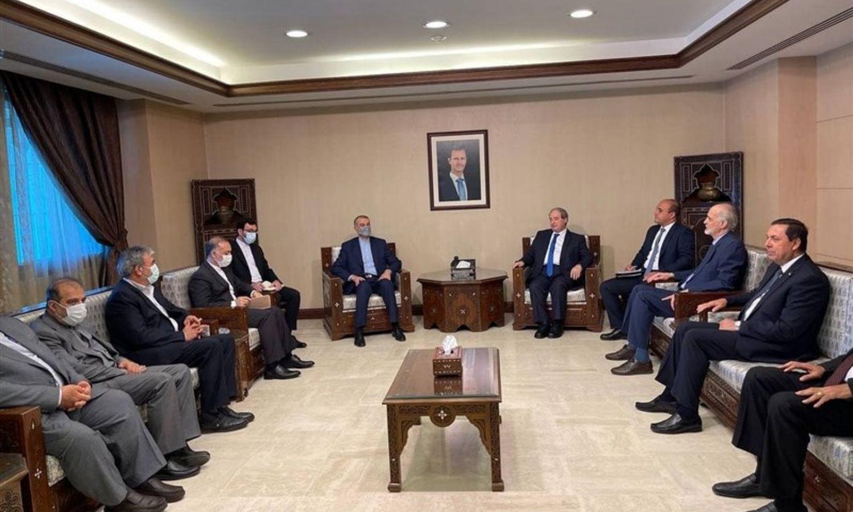 """اجتماع وزير خارجية النظام، فيصل المقداد، مع نظيره الإيراني، حسين أمير عبد اللهيان، في دمشق، وكالة """"تسنيم""""، 2021."""