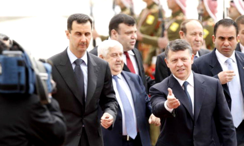 الملك الأردني عبد الله الثاني يستقبل رئيس النظام السوري بشار الأسد في عمان - 20 آذار 2009 (Getty)