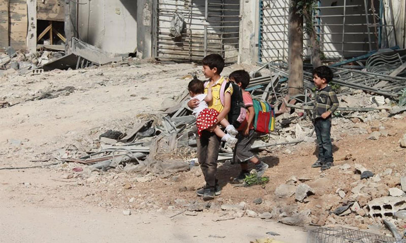 Some children in Daraya in Damascus countryside before leaving the city in August 27th, 2016 (Enab Baladi)