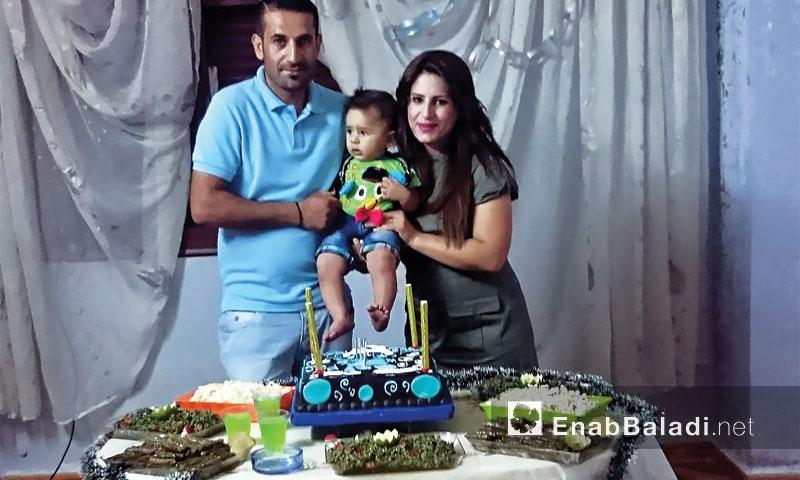 Liwa Souliman with his wife celebrating their son's, Joud, birthday – (Enab Baladi)