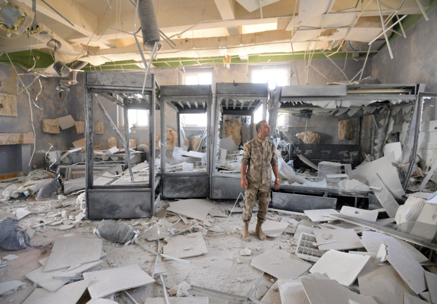 A soldier belonging to Assad's forces at the National Museum of Palmyra after its reclamation (DPA).