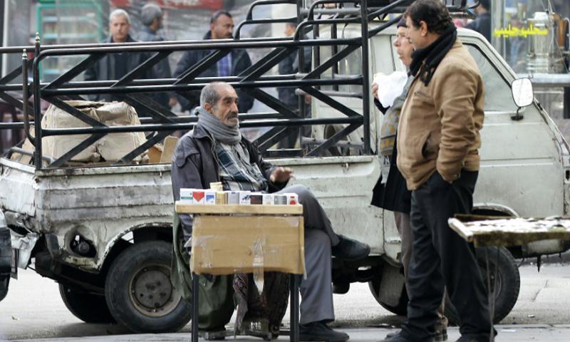 Cigarette seller, Damascus, 17 December 2016 (AFP)