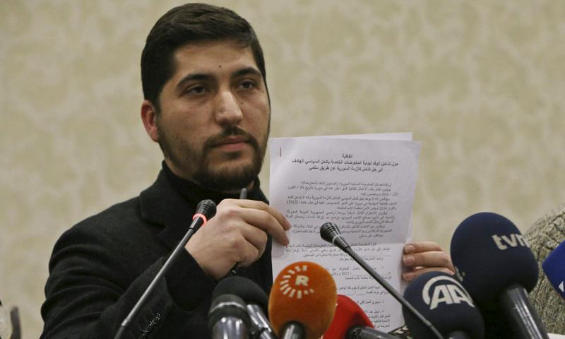 Osama Abu Zaid at a press conference in Ankara, 29 December 2016 (AP)
