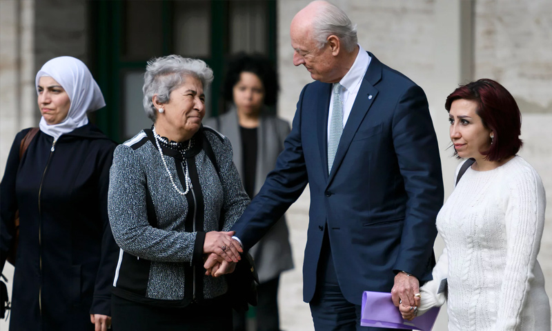 Syrian women whose family members have been detained or victims of enforced disappearance with the UN envoy, Staffan de Mistura, 23 February 2017 (AFP)
