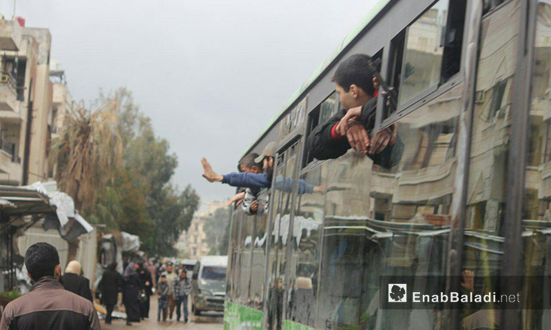 The first convoy of buses carrying al-Waar's residents while leaving to north Syria. March, 18th, 2017- (Enab Baladi)