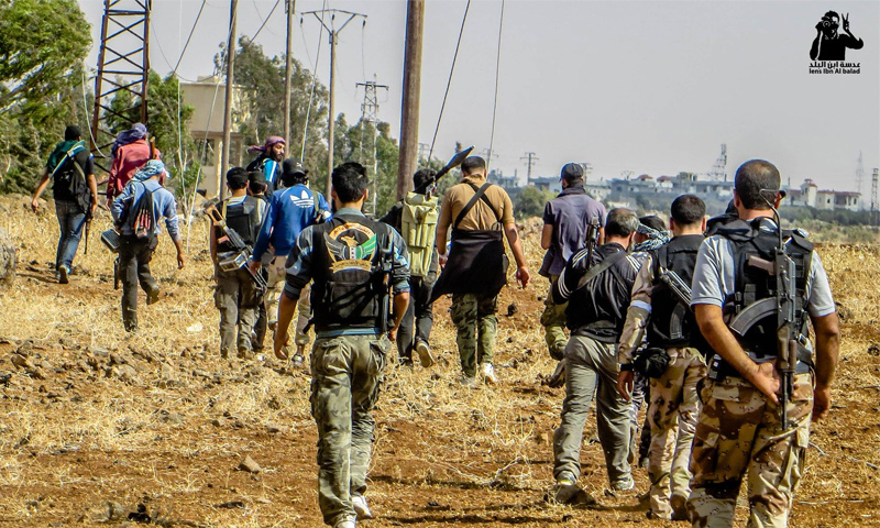 Fighters in an agricultural land in Daraa countryside - 2 August 2014 (Lens of Ibn al-Balad)