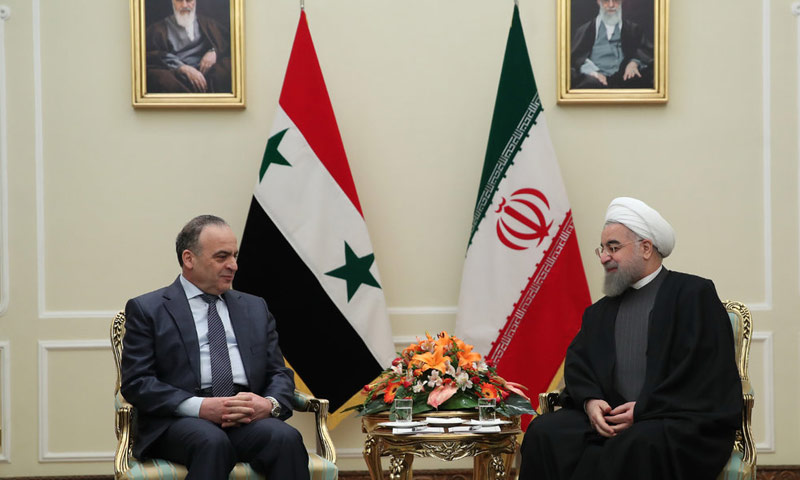 President of the Syrian regime government Imad Khamis and the Iranian President Hassan Rouhani (AFP)