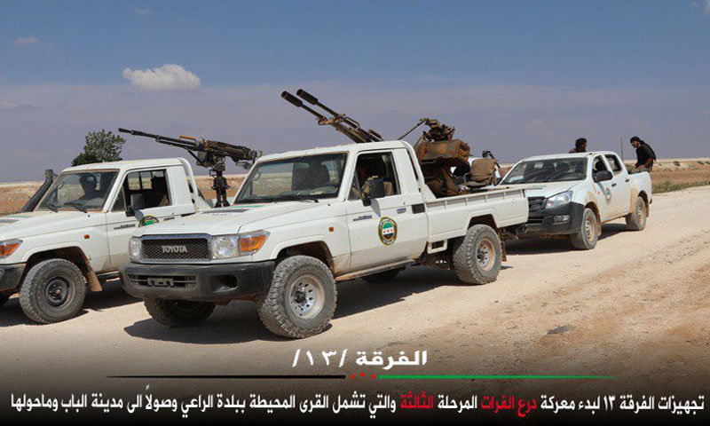 """Archives – military trucks belonging to the """"13th Division"""" (Twitter)."""