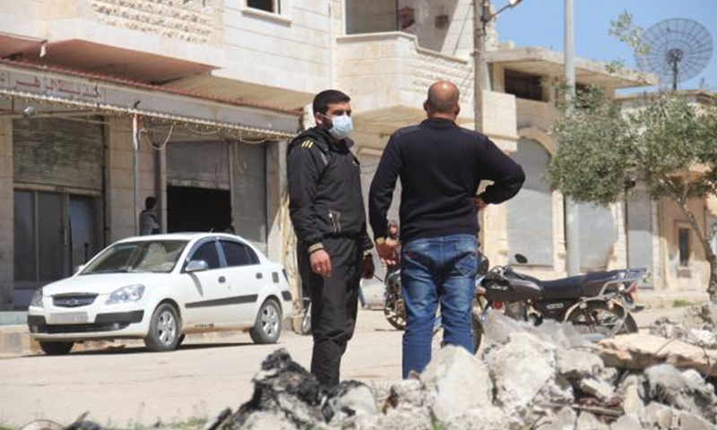 Syrian men collect samples from the site of a suspected toxic gas attack in Khan Sheikhun, in Syria's northwestern Idlib Province, on April 5. File Photo by Omar Haj Kadour/UPI | License Photo