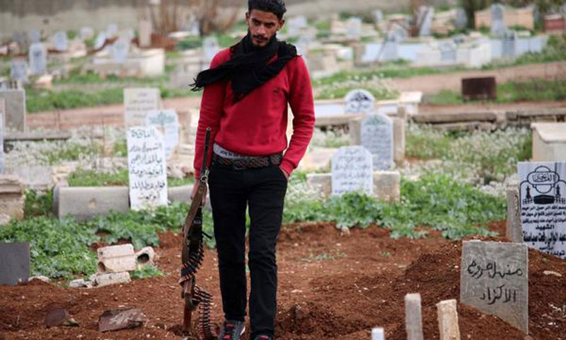 Syrian opposition fighter in a cemetery in Daraa's southern countryside- 20 March, 2017 (AFP)