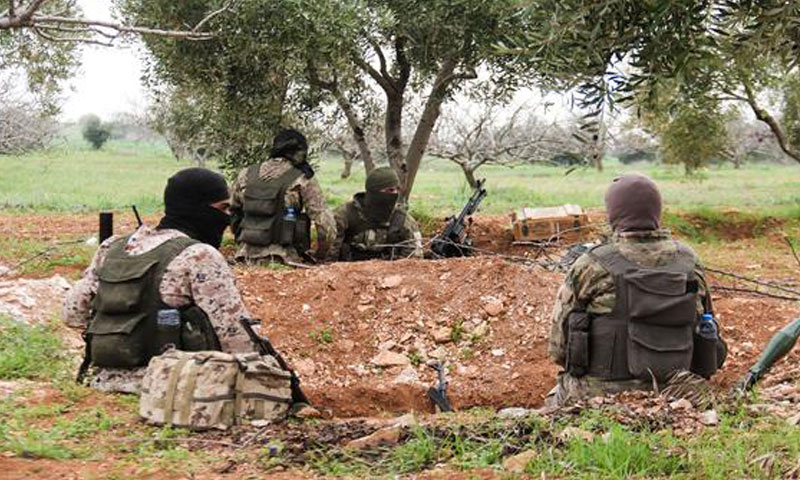 Hay'at Tahrir al-Sham fighters in the town of Maardes, northern countryside of Hama - 22 March 2017 (AFP)
