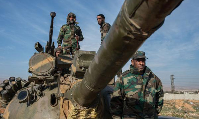 Members of al- Assad forces occupying a tank in eastern Damascus countryside - February 2016 (Sputnik)Members of al- Assad forces occupying a tank in eastern Damascus countryside - February 2016 (Sputnik)