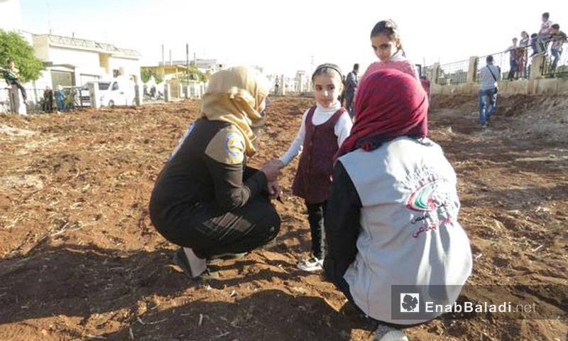 """Expressive image: The preparation of a playground for the children of the city of al-Rastan north of Homs by """"Our Children"""" volunteer team - 10 November 2017 (Enab Baladi)"""