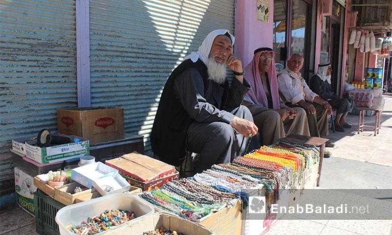Men in one of the city of Qamishli's neighborhoods, September 29, 2016 (Enab Baladi)