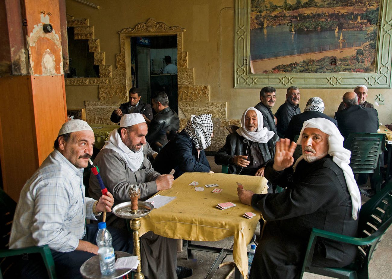 Syrian elders in Damascus café sipping tea and playing cards - 2011 Expressive (alamy)