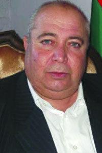 "Hakam Khalu, the joint chairman of the ""Legislative Council of Al-Jazira Province """