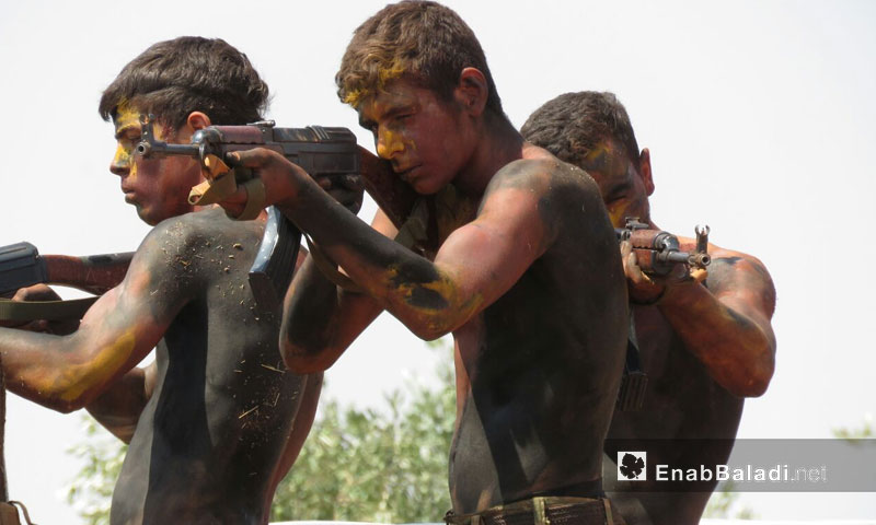 Fighters in the free army training in the countryside of Hama - August 11, 2017 (Enab Baladi)